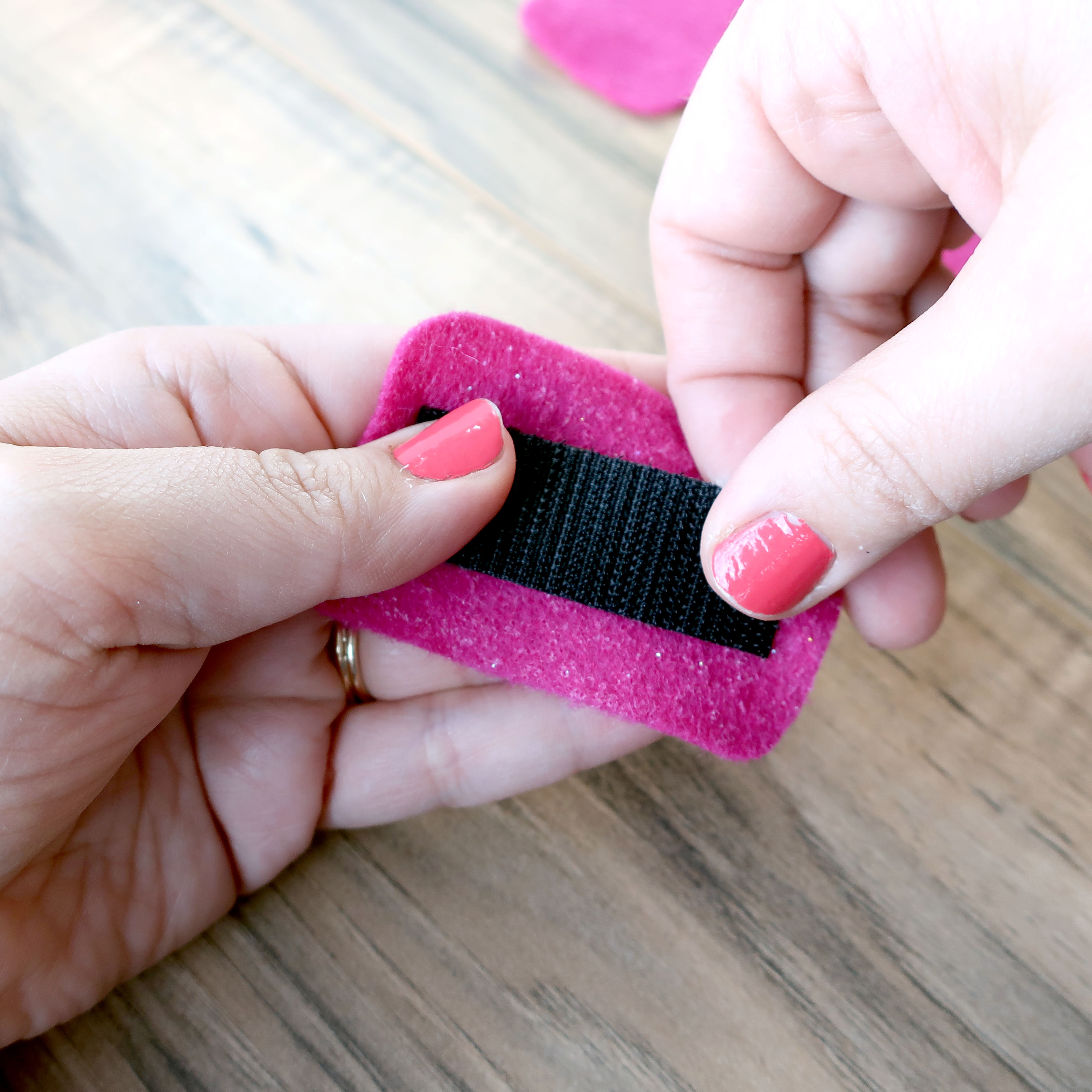 Afix the fastener's adhesive to the felt